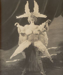 Eva Tanguay probably put this feathered costume together without the benefit of a stylist.