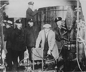 Cops in Detroit inspecting a secret brewery during Prohibition.