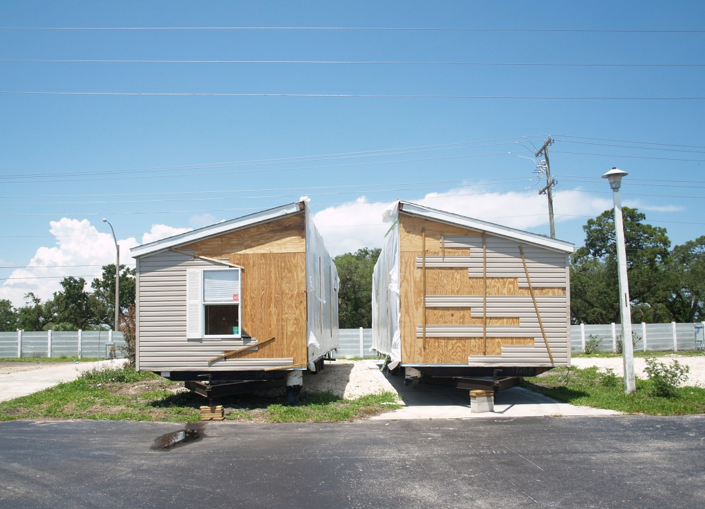 A double-wide home is split in preparation for it to be hauled out of a closing mobile home park in Florida.